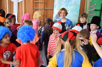 Sarah Holding talking to readers dressed up for World Book Day